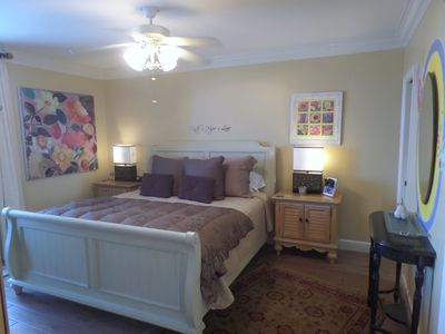 Master bedroom suite with king-size bed and attached bathroom