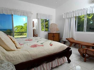 East Villa Master Bedroom with Balcony and Waterview