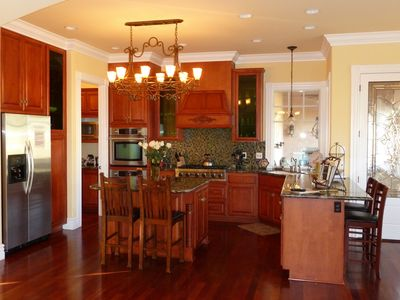 Gourmet kitchen w/2 ovens, Viking stove, glass tile and cherry cabinets, balcony