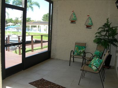 Screened lanai and waters edge