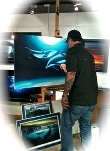 "Famous artist ""Wyland"" often visits his store, a short free trolley ride away."