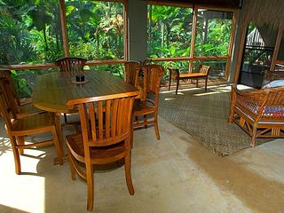 Hanalei house photo - Screened in porch with dining and sitting areas.