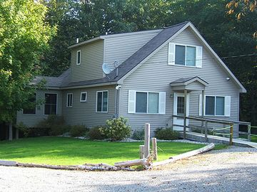 "Maple City house rental - ""Into the Woods,"" a charming, fully-equipped three- bedroom, two-bath home."