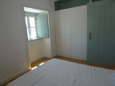 Ericeira cottage rental - Bedroom #1 with queen size bed and two windows. Plenty storage space