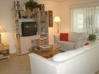 Pompano Beach apartment photo - Living room with sun porch off the side.