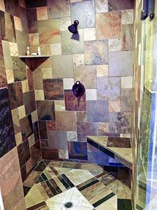 Slate shower in all bathrooms.