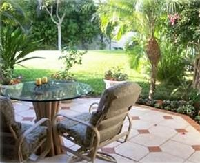 Tiled lanai is a beautiful spot  for your morning coffee or evening cocktail!