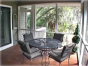 Screened porch off LR and MBR; Stairs to chairs by creek.