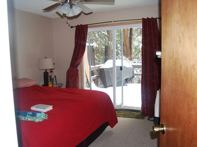 Master Bedroom overlooking snowing deck and woods. King Bed with private bath.