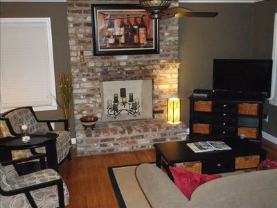 Old Charleston brick fireplace and cozy living area.