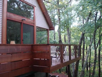 Hang out in the tree tops-on the deck off the Living/Dining Room