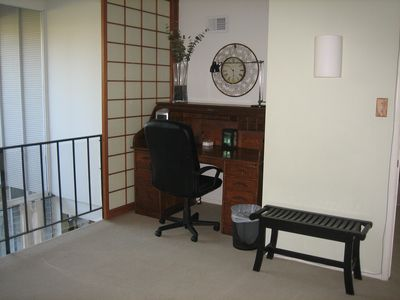A large desk in the Master Loft Bedroom