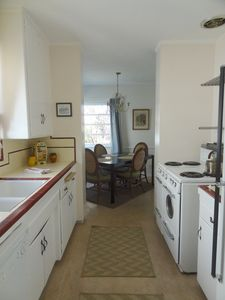 Fully equipped kitchen with 40's style and stove and dining area.