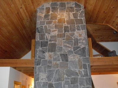 stone chimney with view of loft areas