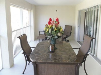 There is an over sized lanai with six chairs and an oval granite table.