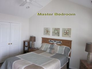 Captains View Villas townhome photo - Master Suite includes large closet, 22x8 deck and full bath with separate stall