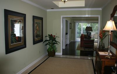 Enter through double doors into a large, welcoming foyer