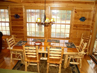 Heavy, Cedar Log dining table seats 8 comfortably.