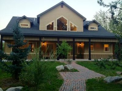 McCall cabin rental - Artisan-Crafted Brick Sidewalk Leading to Entrance at Dusk
