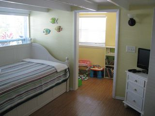 Anna Maria house photo - Bedroom with Twin Daybed/Trundle. Kid's play area stocked with toys and books
