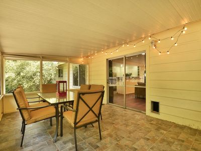 Great screened-in porch overlooks backyard. Entertain or Relax!