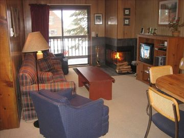 Snowshoe Mountain condo rental - Living area with fireplace and balcony. Sleeper Sofa.