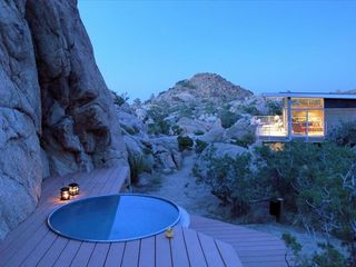 Yucca Valley house photo - Cowboy soak tub is nestled into the boulders.