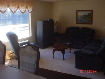 The Upstairs Living Room looks out over the Lake