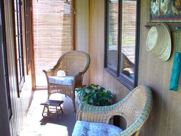 The Screened in Sunroom with many windows to enjoy the gorgeous view