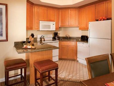 A fully equipped kitchen and separate dining area offer the comfort you need.