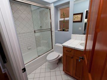 Guest Bathroom #3 on First Floor with Shower and Tub.