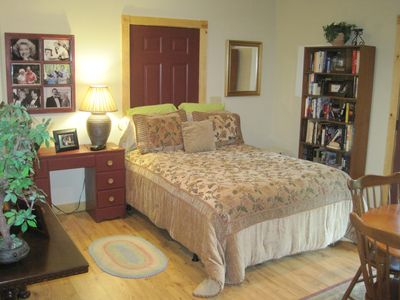 Queen Size Bed In Basement With Plenty of Books