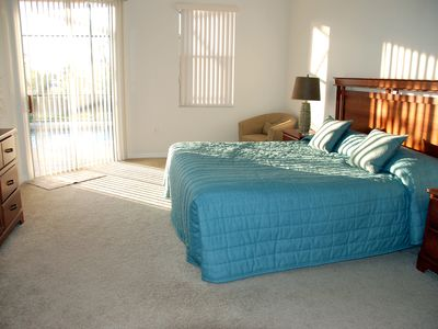 Master Suite1 with king size bed-opens straight onto pool area with sliding door