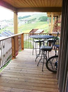 our deck with chairs and table - great place to leave your bikes