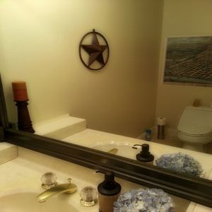 Convenient powder room in the downstairs living area has some Texas flair