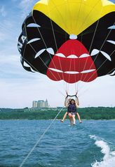 Branson condo photo - Adventurous types may try parasailing over the lake! Courtesy BCC.