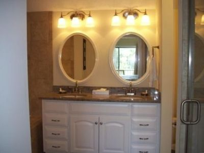 Master bathroom with granite countertops, walk-in shower and x-large tub