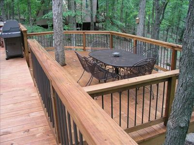 Large Extended Deck with Wrought Iron Table and Chairs. Gas Grill.
