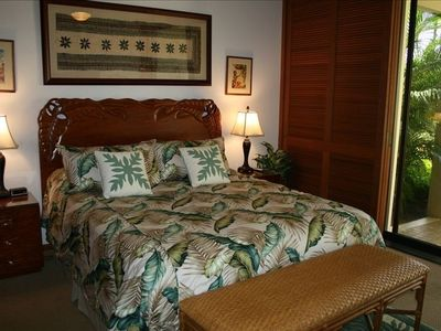 Master suite with designer Hawaiian hand carved furniture & custom made bedding