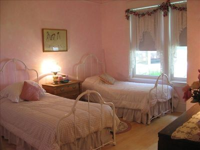 Pink Bedroom: two twin beds, pedestal sink, ceiling fan, closet, dresser