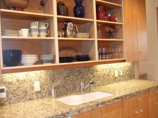 Astoria house photo - The remodeled kitchen features granite, wonderful appliances and ease of use