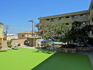 Pacific Beach condo photo - Community area with BBQ and lounge chairs