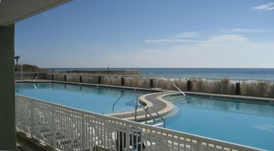 Your view of the large heated freshwater pool and Gulf of Mexico