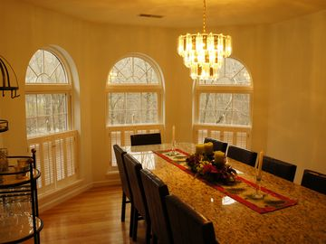 Beautiful marble custom made dinning room table with seating for 12.