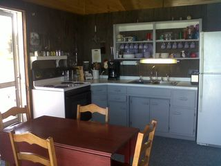 Fully stocked eat-in kitchen! Breakfast bar with 5 stools to the right. - South Hero cottage vacation rental photo