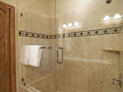 Master Shower with Travertine Tiles and Euro Shower Door