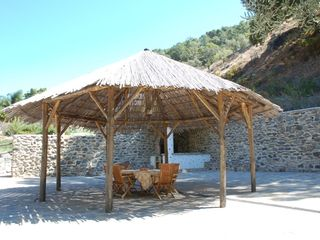 Genalguacil villa photo - 200m2 terrace with a high spacious wooden pergola in the middle