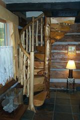 Thousand Islands cabin photo - Hand crafted Maple log staircase