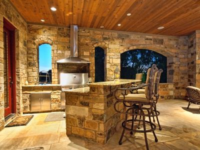Enjoy outdoor entertaining with kitchen, bar, dining and tons of seating!