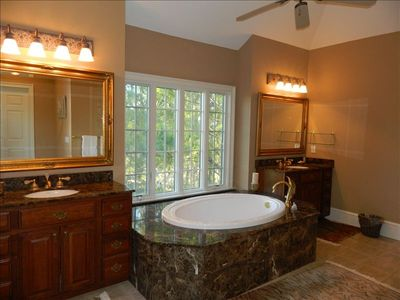Master Bath features 2 sinks,tub,open shower, attached laundry, & walk-in closet